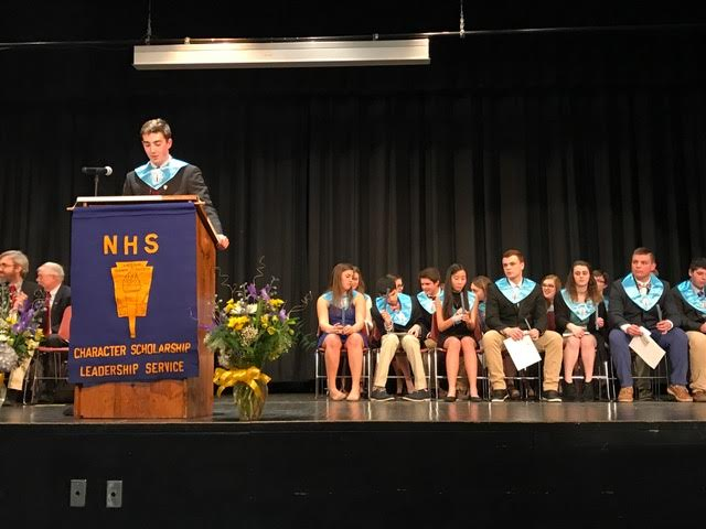 NHS President Owen Brown addresses members and new inductees