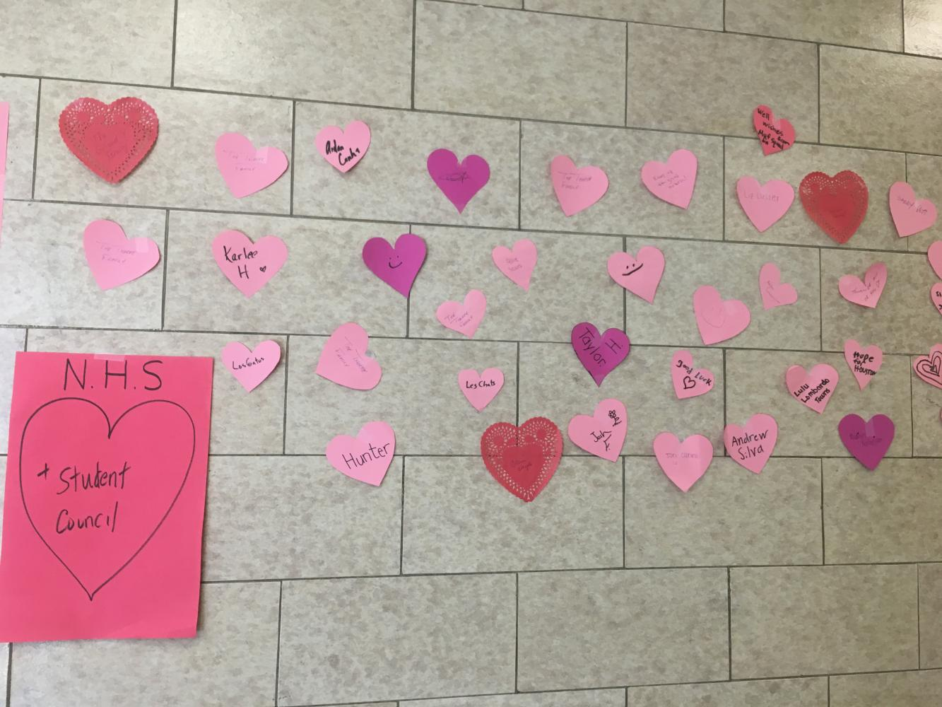 Hearts adorn the wall outside of the school store.