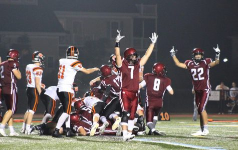 Cody Burke (7) and Daylon Lark (22) celebrate what they think is a touchdown run in by Gloucester