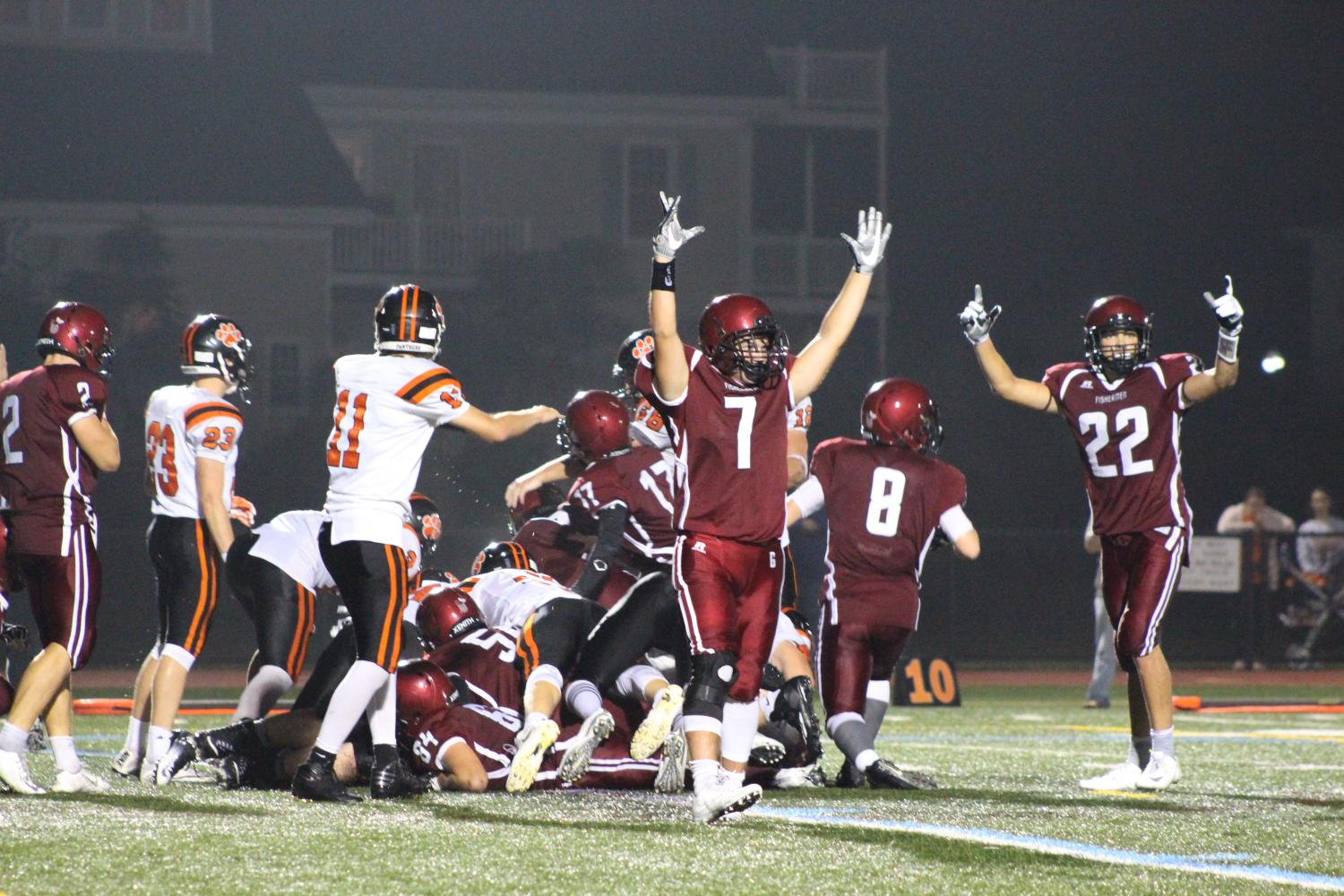 Cody+Burke+%287%29+and+Daylon+Lark+%2822%29+celebrate+what+they+think+is+a+touchdown+run+in+by+Gloucester