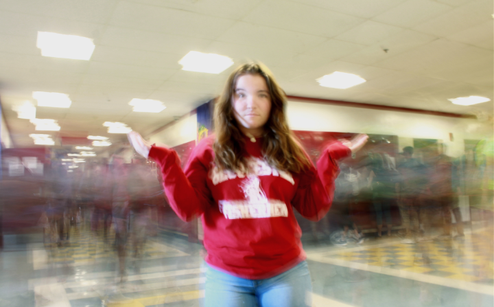 Caroline Enos stands in the chaos that has become the hallways at GHS