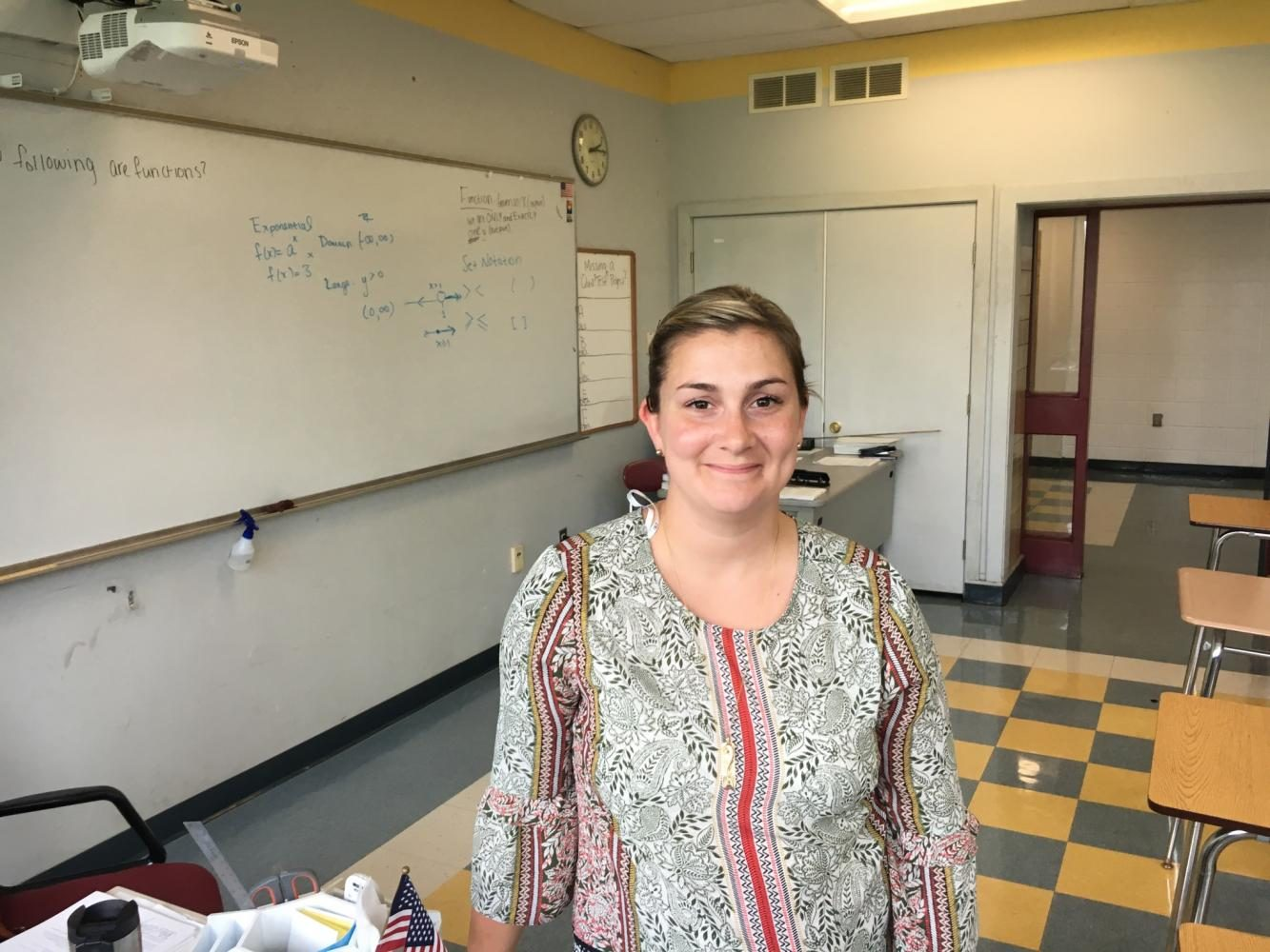 Amber McGlynn poses a smile in her new classroom.