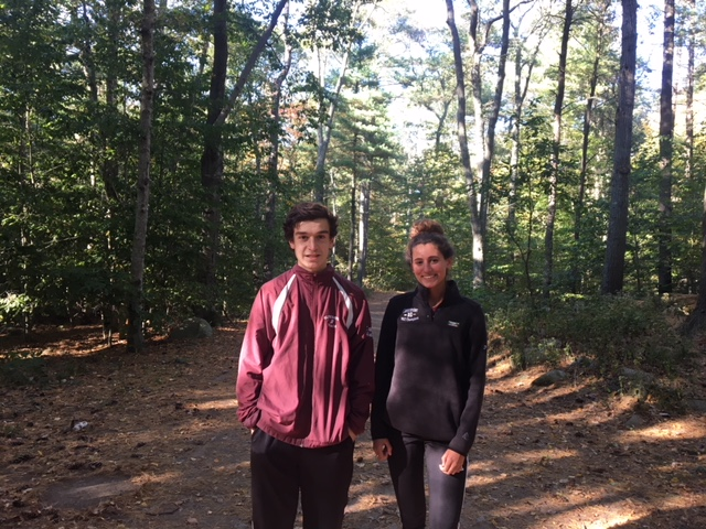 Captains Kory Hurd and Lindsey Parisi smile for a picture at their meet in Ravenswood Park.