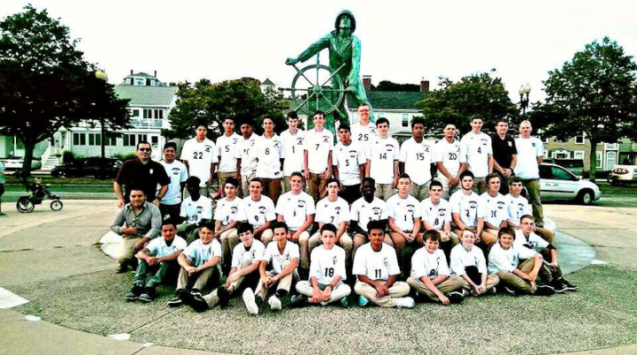 GHS boys soccer team poses for a team picture in front of the Fishermen's Memorial at the beginning of the season. The team's diverse roster hopes to score a championship win this season