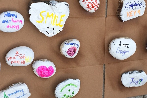 Rocks adorned with positive messages greet students as they walk into GHS