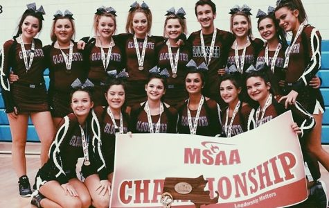 GHS Cheerleaders pose with their State Championship trophy.