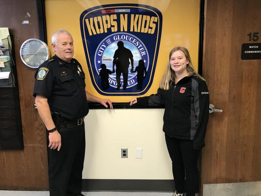 Gloucester police chief John McCarthy and Marisa Orlando pose with the Kops-N-Kids logo