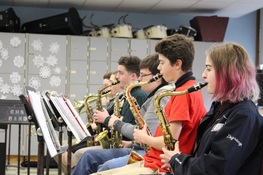 (from left)  Sam Groleau , Kelsey Lowthers, Ivan Demarjian, Logan Wieckowski, Owen Hardy, and Rose Degrange practice scales during music class