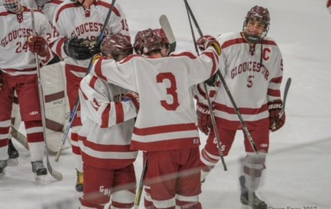Gloucester hockey players celebrate a goal