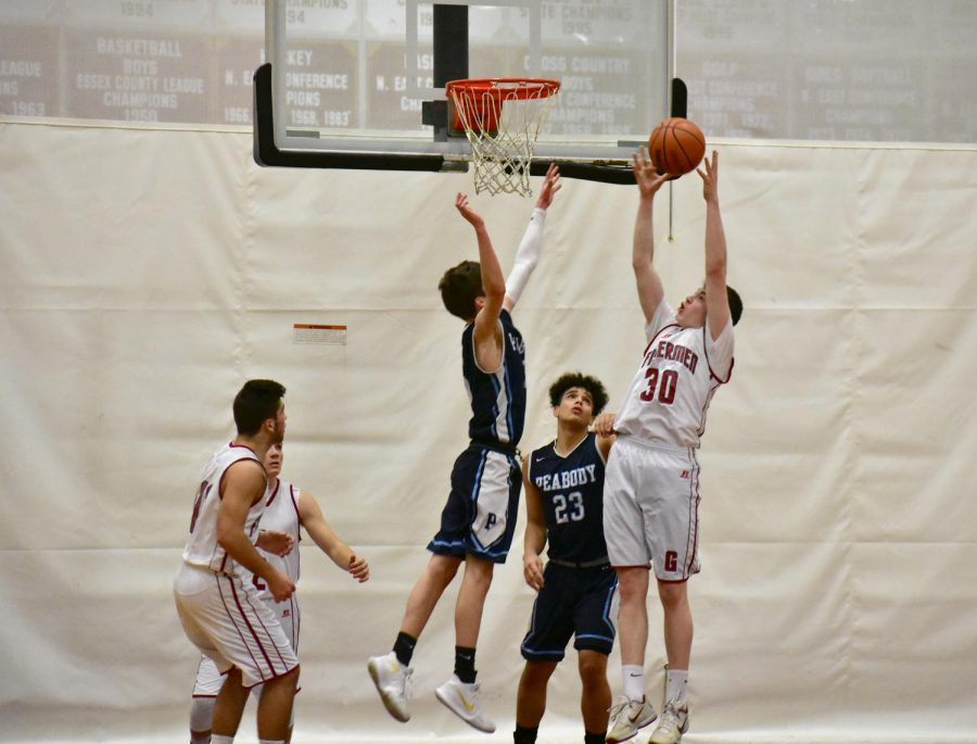 A rebound attempt by Gloucester against Peabody in a regular season game