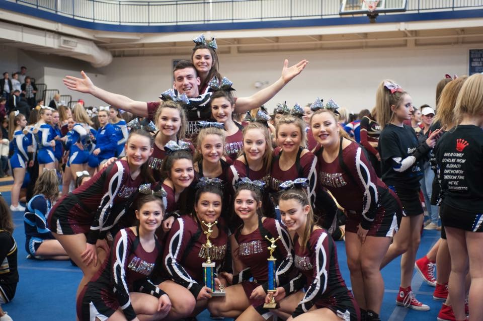 GHS cheerleaders pose with the first place trophy at North Regional Competition last weekend
