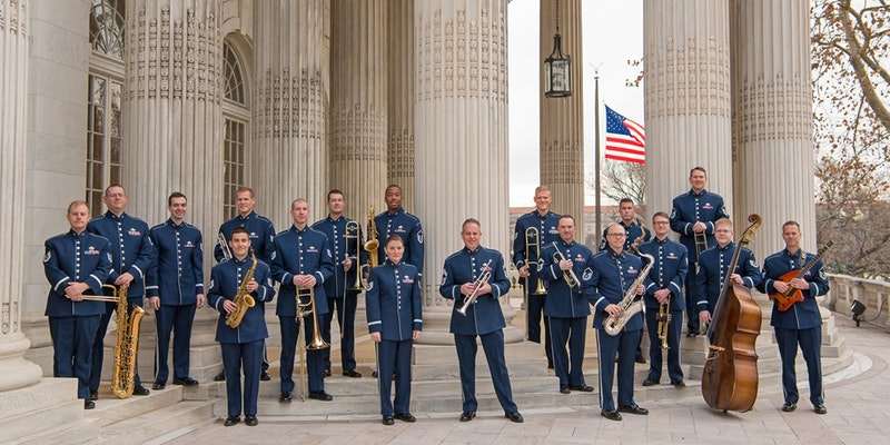 The USAF Airmen of Note stand in uniform with their instruments.