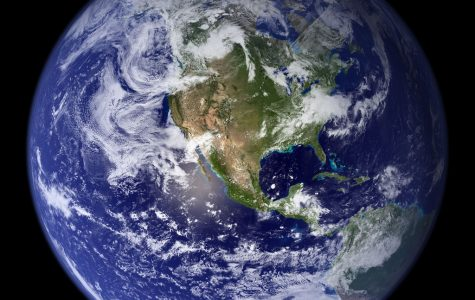 Climate Change, Capitalism, and The Worldwide Symbiote