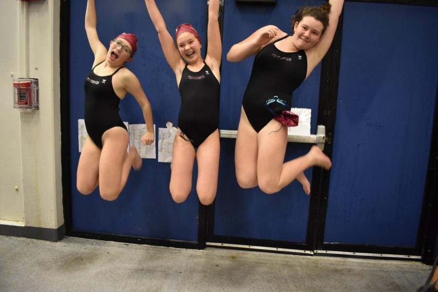 """Abby Cook, Thea Cunningham, and Willow Barry celebrate a successful meet with a leap.  Gloucester came in 7th out of 13 teams.   As Sam Cook said, """"None of our swimmers got last place, that's a win in my book!!"""""""