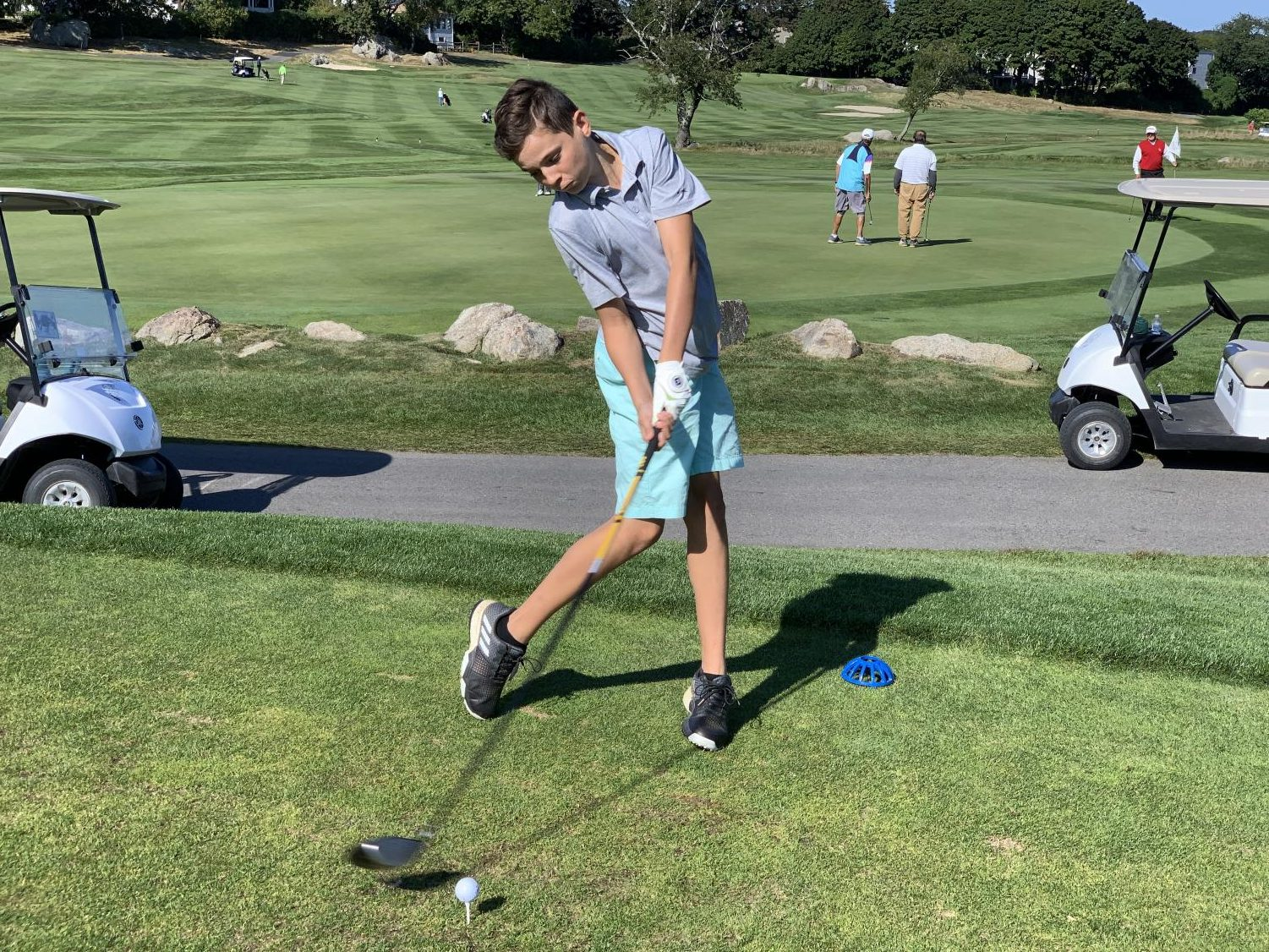 Freshman Michael Calamo drives the ball on the first hole at Bass Rocks Golf Club