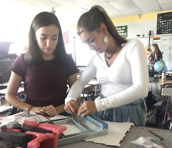 Sophomores Jenna Smith and Sophia Costa work on a Vex 5 Clawbot in E block  Robotics class