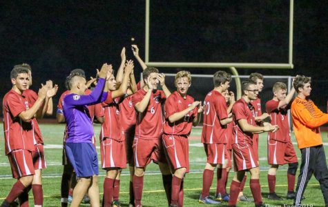 Boys soccer team celebrates after a win.