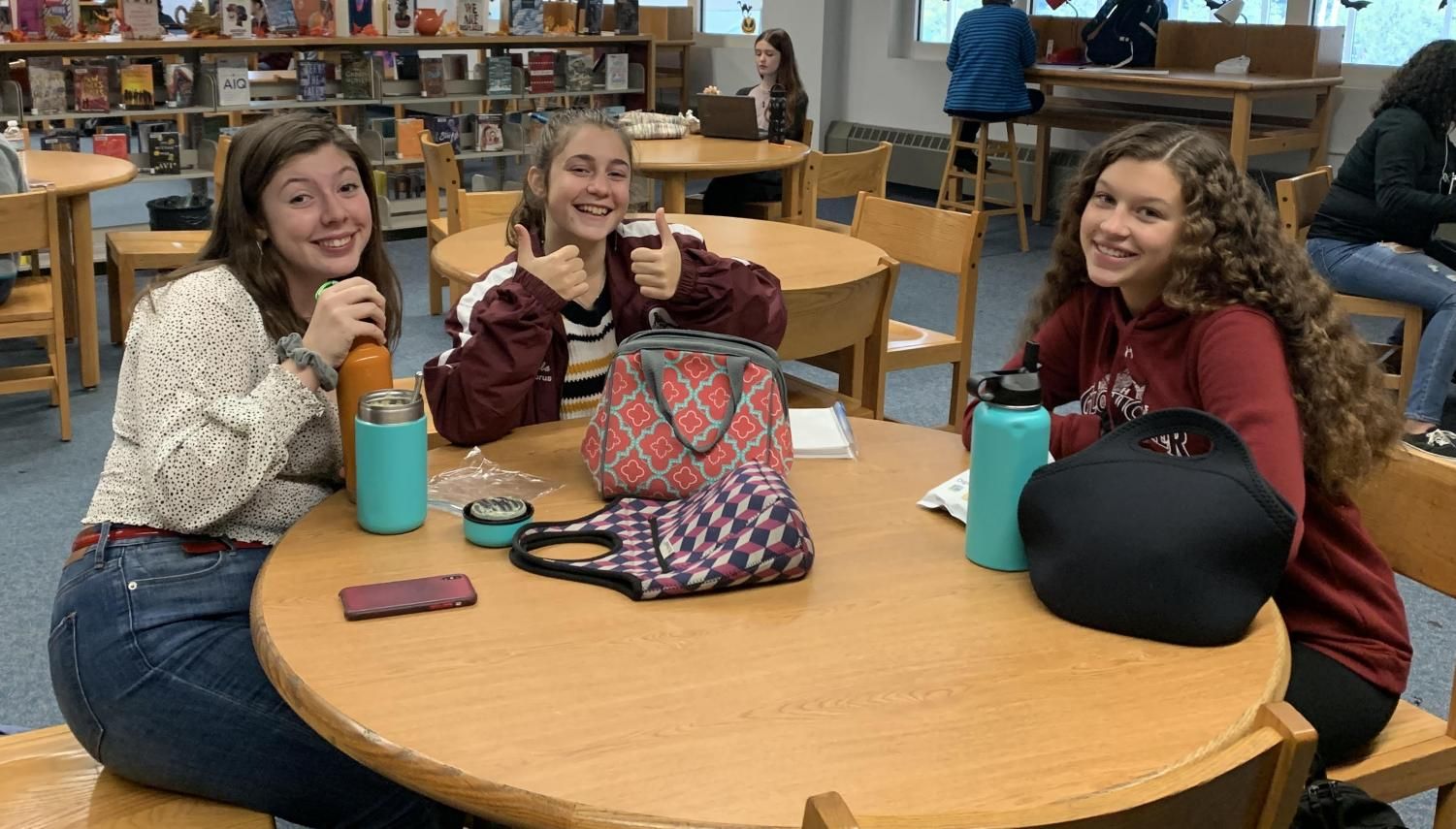 (from left) Asha Egmont, Isabella Giordano, and Haley Weed enjoy lunch in the Library Learning Commons