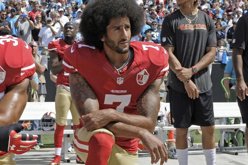 Colin Kaepernick kneels during the National Anthem to protest police brutality and racial inequality in the U.S.