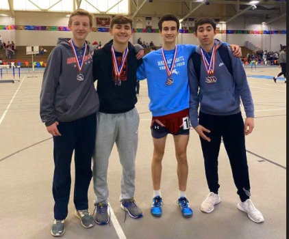 Daniel Hafey, Andrew Coelho, Harrison Pelosi and Kai Deguzman pose with their medals after the NEC Championship