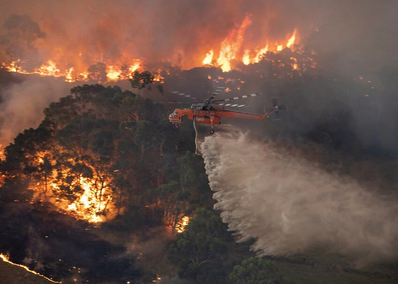In+this+Monday%2C+Dec.+30%2C+2019+photo+provided+by+State+Government+of+Victoria%2C+a+helicopter+tackles+a+wildfire+in+East+Gippsland%2C+Victoria+state%2C+Australia.+Wildfires+burning+across+Australia%27s+two+most-populous+states+trapped+residents+of+a+seaside+town+in+apocalyptic+conditions+Tuesday%2C+Dec.+31%2C+and+were+feared+to+have+destroyed+many+properties+and+caused+fatalities.+%28State+Government+of+Victoria+via+AP%29