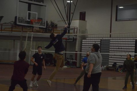 Patrick Hunt flies through the air to spike the ball