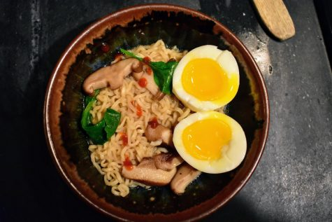 Ramen, topped with an egg and bit of sriracha, and ready to eat!