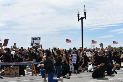 Demonstrators kneel in honor of George Floyd at the Black Lives Matter protest