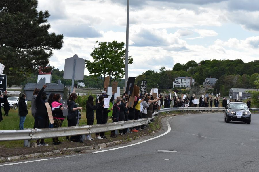 Protesters stand in solidarity to support the Black Lives Matter movement
