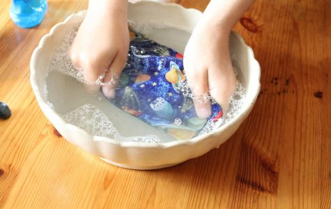 Ais Cook properly washing their mask with dish soap and water