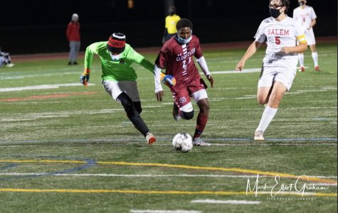 Senior Robert Mugabe rounds the keeper to score  his second goal of the night