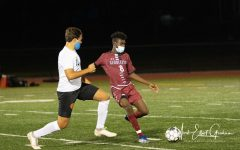 Sophomore Yuniel Sanchez Batiz takes on the Beverly defender Nick Braganca in their game on Tuesday night
