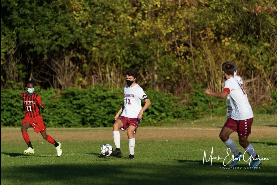 Senior Captain Owen Hardy plays the ball up in the game against Salem