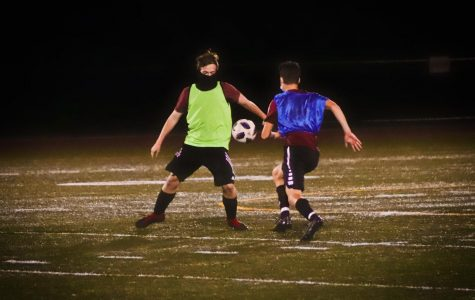 Keith Horne and Jack Patten battle for the ball during boys soccer practice