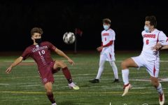 Junior Andrew Coelho controls the ball as defenders approach