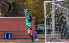 Freshman Aleena Dort makes a leap for the ball while playing goalie a few weeks ago.