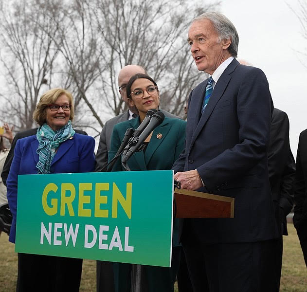 Senator Edward Markey (right) and Representative  Alexandria Ocasio-Cortez promoting The Green New Deal on Capitol Hill in February of 2019
