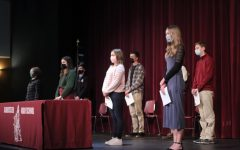 Students stand masked and socially distanced as they accept their Sawyer Medal awards