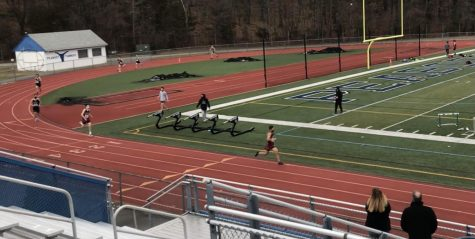 Andrew Coelho and Tommy Elliott round the corner as the lead the 600m dash.