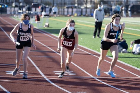 Junior Jenna Smith and two opponents begin the relay.