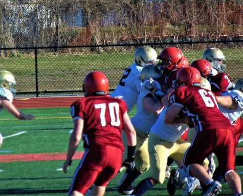 A swarming Gloucester defense stops the run.