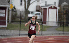 Freshman Faith Castellucci rounds the turn in the 1000m.