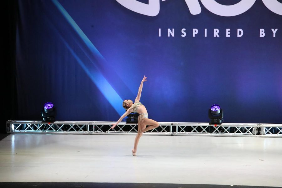 Caitlyn+Muniz+leaps+across+the+stage+at+a+competition