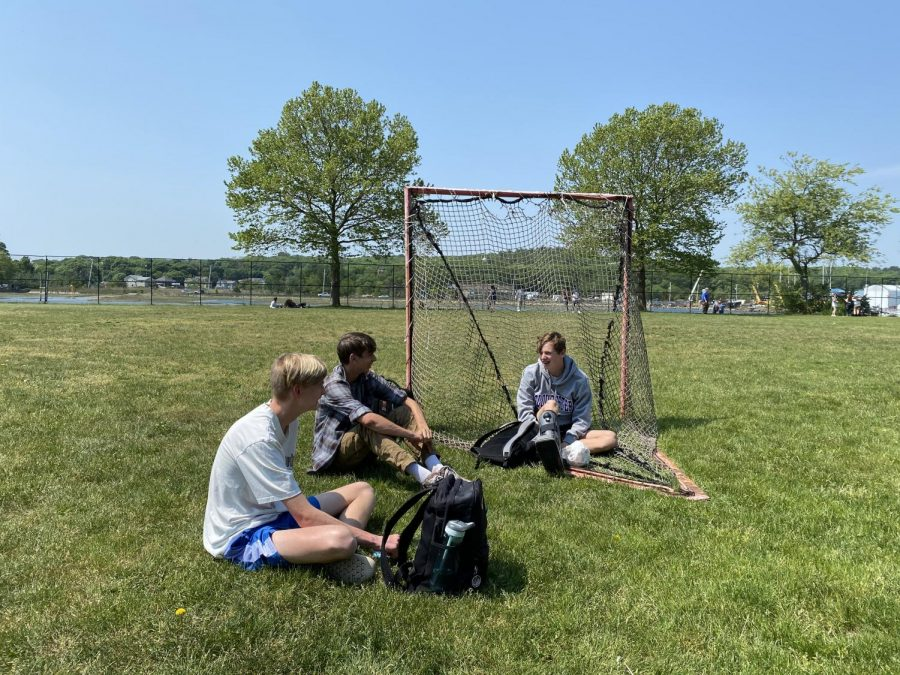Sophomores Max Littman, Sam Ashwell, and Deston Cauthers enjoy the nice weather after lunch.