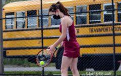 Junior Isabelle Nixon prepares to serve in her singles match