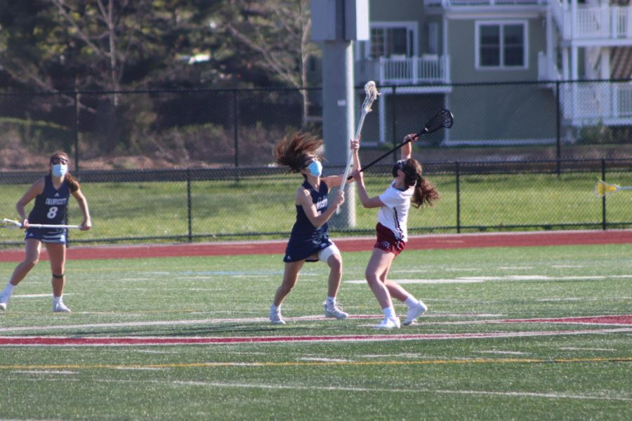 Faith Brown battles with Swampscott opponent in Monday's game.