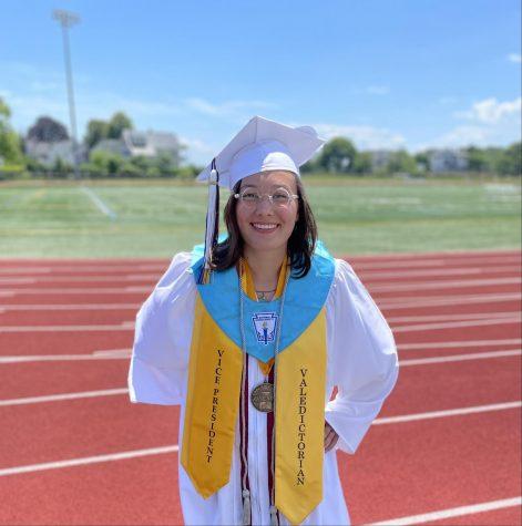Valedictorian Mila Barry poses at Newell Stadium on graduation day