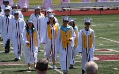 Class officers lead their classmates to the commencement ceremony