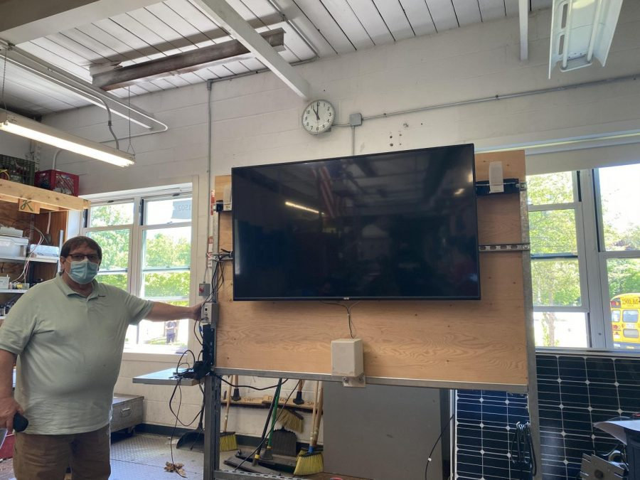 Electrical teacher Mr. Devlin demonstrates the mobile classroom his students created.