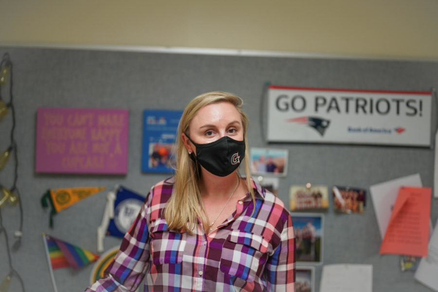 Mrs.+Alves+sporting+a+Gloucester+Athletics+mask+in+her+new+office.